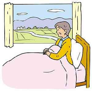 病院の部屋の窓から景色を眺める女性