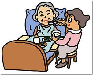 介護を受けながら食事をする高齢者