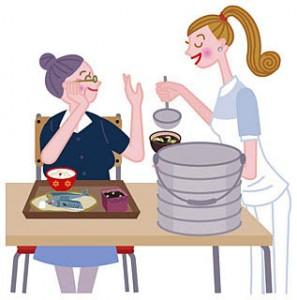 食事を作る娘と話が止まらない高齢者