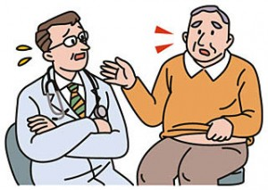 医師と話をする男性