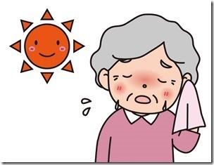 太陽の下で汗をふく高齢者