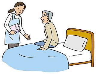 ベッドのところで介護士と高齢者