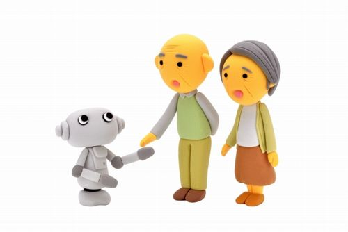 介護ロボットが高齢者と握手